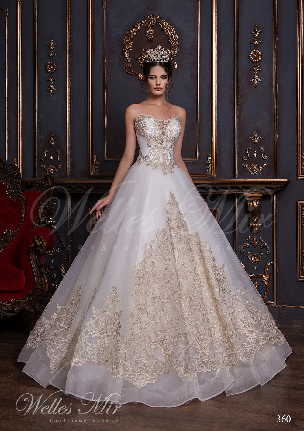 Open wedding dress with a gold embroidery and applications 360